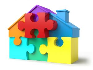 Clipart of a house made from puzzle pieces